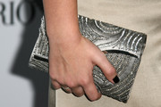Jasper Polish went all out with the shimmer at the Teen Vogue Young Hollywood party, pairing a glam sequined silver clutch with her gold outfit.