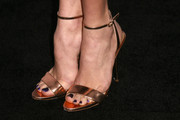 Peyton List wore super-elegant gold evening sandals to the Teen Vogue Young Hollywood party.