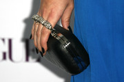 Sophie Simmons glammed it up with a black hard-case clutch featuring bejeweled finger holes during the Teen Vogue Young Hollywood party.