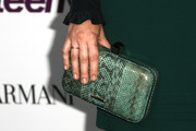 Amanda Michalka's teal snakeskin clutch provided a chic finish to her look during the Teen Vogue Young Hollywood party.