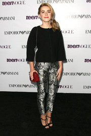 Kiernan Shipka's iridescent print pants and loose black blouse at the Teen Vogue Young Hollywood party were a very elegant pairing.
