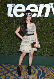 Jenna Ortega finished off her eclectic ensemble with a metallic box clutch by Emm Kuo.
