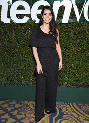 Auli'i Cravalho matched her outfit with a black satin clutch.