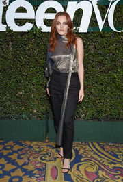 Madeline Brewer paired her top with black slacks.