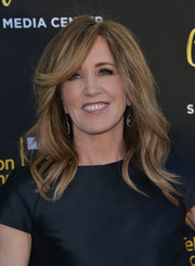 Felicity Huffman was fabulously coiffed with billowy waves and side-swept bangs at the Television Academy's 70th anniversary gala.