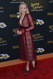 Portia Doubleday completed her stylish ensemble with black mesh pumps by Soebedar.
