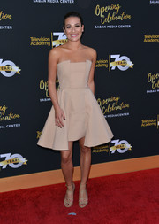 Lea Michele complemented her dress with nude gladiator heels.