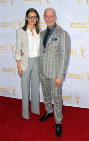 Stana Katic was menswear-chic in a pearl-gray blazer layered over a white button-down at the Costume Design Emmy Nominee Reception.