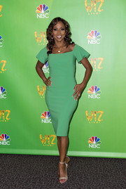 Holly Robinson Peete paired her dress with nude patent ankle-strap heels.