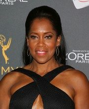 Regina King opted for a classic half-up style when she attended the Television Academy reception for Emmy-nominated performers.