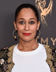 Tracee Ellis Ross jazzed up her simple hairstyle with a pair of gold hoops.