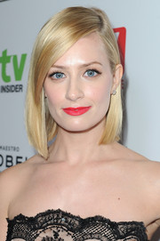 Beth Behrs added a jolt of color with bright red lipstick.