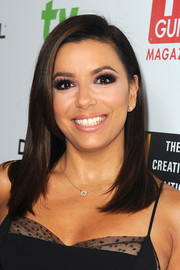 Eva Longoria made her peepers pop with pink eyeshadow.