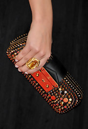 Amaia Salamanca displayed her stunning Louis Vuitton studded clutch. The gold and silver studs were just what her basic LBD needed.