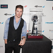 Josh Henderson dressed up a casual button down with a simple black vest.