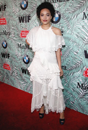 Kiersey Clemons finished off her look with a pair of navy platform sandals.