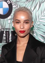 Zoe Kravitz hit the Women in Film pre-Oscar cocktail party wearing her hair in a micro-braided ponytail.