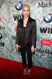 Zoe Kravitz kept it understated in a black blazer layered over a matching top at the Women in Film pre-Oscar cocktail party.