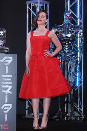 Emilia Clarke went for vintage-inspired cuteness in a bustled red fit-and-flare dress by Christian Dior at the 'Terminator Genisys' premiere in Tokyo.