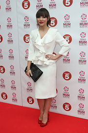 Roxanne Pallett looked classic and sophisticated in a white skirt suit with ruffled jacket while attending the Tesco Mum of the Year awards.