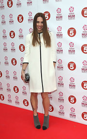 Mel C finished off her ensemble in edgy style with a pair of two-tone captoe ankle boots.
