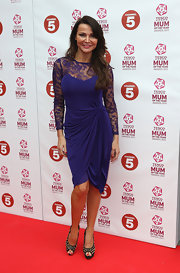 Lizzie Cundy looked glamorous in this purple cocktail dress with lace neckline and sleeves.