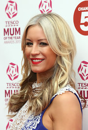 Denise van Outen's red lips popped against her bronzed skin and blonde locks.