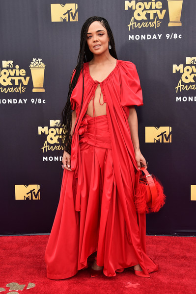 Tessa Thompson Fur Purse [movie,flooring,carpet,red carpet,fashion,shoulder,joint,costume,tessa thompson,tv awards,santa monica,california,barker hangar,mtv]
