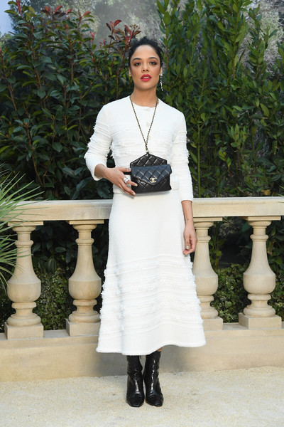 Tessa Thompson Quilted Leather Bag [haute couture spring summer,chanel haute couture spring summer 2019,clothing,white,dress,lady,fashion,shoulder,footwear,waist,knee,street fashion,tessa thompson,front row,part,paris,france,chanel,paris fashion week,show]