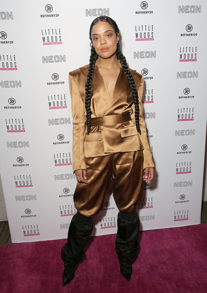 Tessa Thompson Pantsuit [little woods,hair,clothing,hairstyle,carpet,fashion model,red carpet,fashion,fashion design,long hair,outerwear,carpet,tessa thompson,neuehouse hollywood,los angeles,neon and rooftop cinema club,refinery29,rooftop cinema club,premiere,pink carpet premiere]