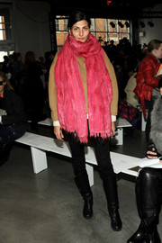 Giovanna Battaglia bundled up in a massive pink fur scarf for the Thakoon fashion show.
