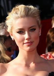 Amber Heard added some drama to her look with smoky eyes and full lashes.