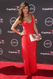 Katie Cleary's ruby red gown featured sexy cutout details on the sides for just a touch of revealing skin.