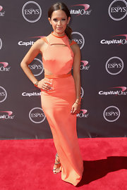 Rocsi Diaz opted for a fun, peach-colored gown with futuristic-like cutouts at the neck for her look at the ESPYS.