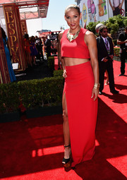 Lolo Jones shows off her killer abs in a red hot crop top.
