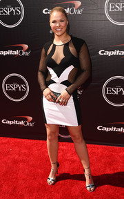 Ronda Rousey complemented her dress with a pair of black and silver T-strap sandals.
