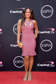 Laila Ali amped up the sex appeal with a pair of gold multi-strap heels.