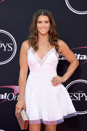 Danica Patrick attended the 2017 ESPYs sporting a silver box clutch and little white dress combo.