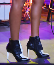 Solange Knowles looked fierce as ever in these open-toe, black and white ankle booties.