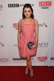Maisie Williams chose a pair of black Jimmy Choo Pearl sandals to team with her frock.