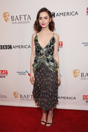 Lily Collins donned a low-cut mixed-print dress by Christian Dior for the BAFTA tea party.