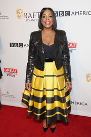 Niecy Nash arrived for the BAFTA tea party looking rocker-chic in a sequined biker jacket.