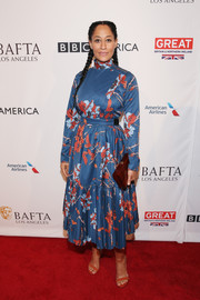 Tracee Ellis Ross stayed conservative in a long-sleeve, high-neck floral frock by Polite at the BAFTA tea party.
