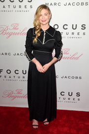 Kirsten Dunst was all about old-school elegance in an ankle-length black shirtdress by Gucci at the New York premiere of 'The Beguiled.'