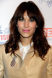 Alexa Chung stayed true to her care-free style with this wavy 'do with thick, choppy bangs.