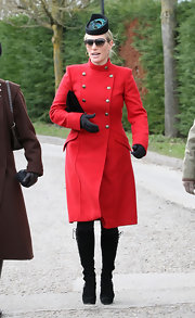 Zara Phillips looked classic and sophisticated in a red fitted wool coat with brass button embellishments.