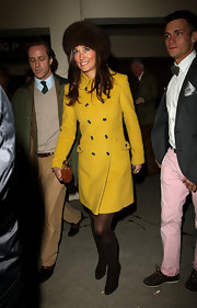 Pippa Middleton sported a classic wool coat with a double row of buttons in a fun yellow shade while attending the races in Cheltenham.