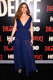 Margarita Levieva looked hot in a sheer blue Dior gown with a plunging neckline at the New York premiere of 'The Deuce.'