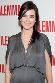 Jennifer Connelly styled her polished brunette locks in a half up hairstyle.