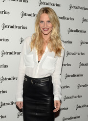Poppy Delevingne attended the Event Paper photocall wearing a leather skirt styled with a studded black belt.